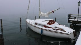 Sailboat, winter, snow, lake, traunsee, attersee. Sailboat at winter, snow and ice, lake, traunsee, attersee stock footage