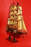 Sailboat. Wood Sailboat Handcraft with Red Brackground Stock Photography