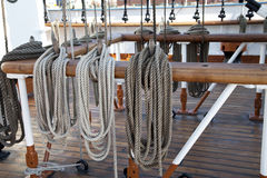 Sailboat wooden marine rigs and ropes. Royalty Free Stock Photo