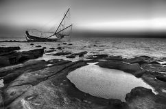 Sailboat Wreck, Yacht Rotted and ruined. Ia a black and white photo Stock Image
