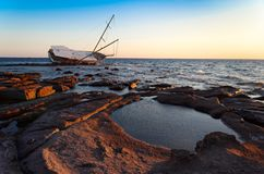 Sailboat Wreck, Yacht Rotted and ruined. On sunset Stock Photography