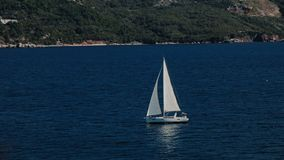 A sailboat, yacht on the horizon in the Adriatic sea stock footage