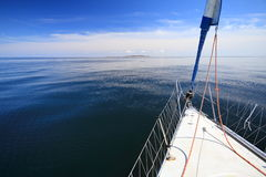Sailboat yacht sailing in blue sea. Tourism Stock Photography