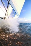 Sailboat yacht sailing in blue sea. Tourism Stock Images