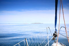 Sailboat yacht sailing in blue sea. Tourism Stock Photos