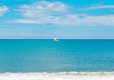 Sailboat yacht sailing sea ocean water on the horizon, summer sport Royalty Free Stock Image