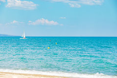 Sailboat yacht sailing sea ocean water on the horizon, summer sport Royalty Free Stock Photo