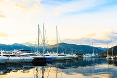 Sailboat and yachts. Port in Mediterranean sea at sunset. Royalty Free Stock Photography