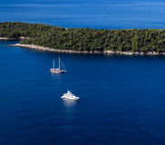 Sailboat and yatch beside Lokrum island in Dubrovnik Mediterrane Stock Photo