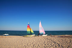 Sailboats. Colored sailboats on the beach Stock Photo