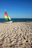 Sailboats. Colored sailboats on the beach Stock Image