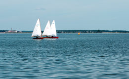 Sailboats. Three sailboats racing on the lake Stock Images