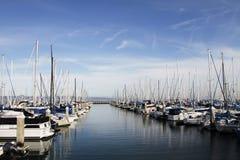 Sailboats. Rows of sailboats docked at a pier stock image