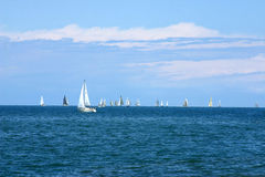 Sailboats. Sailing on the horizon on a beautiful sunny day Royalty Free Stock Photos