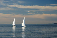 Sailboats. Two sailing boats in the sea stock photos