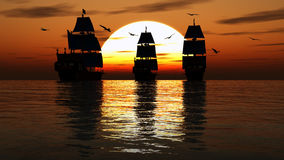 Sailboats against a beautiful landscape. Pirate ships silhouettes against an ocean sunset. Old wooden pirate ships with full flags as the sun sets on the ocean Stock Photos