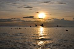 Sailboats against beautiful sunset in Boracay.  Stock Photo