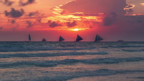Sailboats against beautiful sunset in Boracay Philippines. 4K TimeLapse - August 2016, Boracay, Philippines stock video