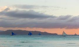 Sailboats against sunset on Boracay island Royalty Free Stock Image