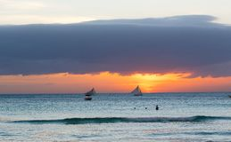 Sailboats against sunset on Boracay island Royalty Free Stock Images