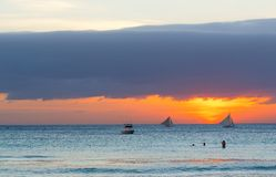 Sailboats against sunset on Boracay, Philippines Royalty Free Stock Photos