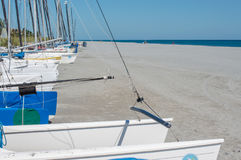 Sailboats along the sand on Delray Beach in Florida. Boats for rent lined up along the sand at Delray beach in Florida stock photos