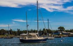 Sailboats at Anchor. Sailboats near shore at anchor in a Maine harbor Stock Photos