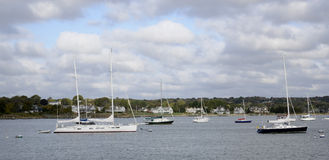 Sailboats anchored in a harbor Stock Photography