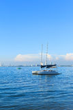 Sailboats anchored on Pattaya City background Royalty Free Stock Photo