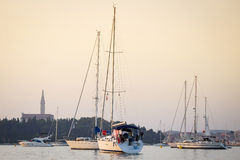 Sailboats anchored in Rovinj harbour Royalty Free Stock Photo