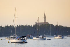 Sailboats anchored in Rovinj harbour at sunset Royalty Free Stock Images