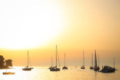 Sailboats anchored at sunset in Adriatic sea Stock Photography