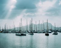 Sailboats And Pleasure Boats In The Porto Grande Bay Of The Historic City Mindelo. Clodscape With Sunrays Royalty Free Stock Photography