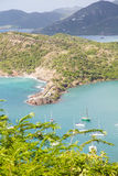Sailboats in Aqua Bay of Antigua Royalty Free Stock Image