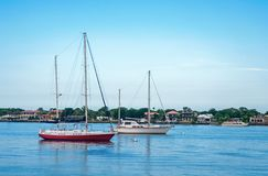 Sailboats in a bay royalty free stock images