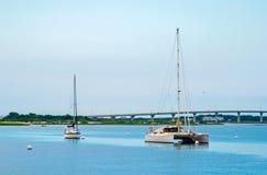 Sailboats in a bay stock image