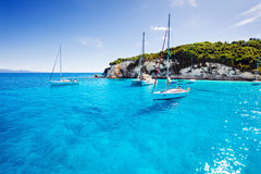 Sailboats in a beautiful bay, Paxos island, Greece Royalty Free Stock Photography