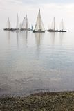 Sailboats in calm water. Many sailboats as seen from beach in pacific northwest, calm glassy water, puget sound washington state Stock Photo
