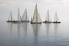 Sailboats in calm water. Many sailboats as seen from beach in pacific northwest, calm glassy water, puget sound Stock Photography