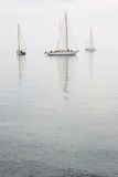 Sailboats calm water fog royalty free stock photo
