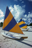 Sailboats Cayman Island. Sailboats line a part of seven-mile beach on Grand Cayman Island. Seven Mile Beach (SMB) is a long crescent of coral-sand beach on the Royalty Free Stock Images