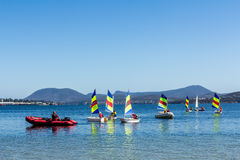 Sailboats on crystal clear blue water Royalty Free Stock Photo