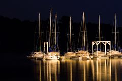 Sailboats in the dark Royalty Free Stock Photo