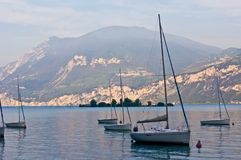 Sailboats on dawn, lake Garda Royalty Free Stock Image