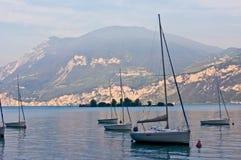 Sailboats on dawn, lake Garda. Italy Royalty Free Stock Image
