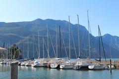 Sailboats dock at Lake Riva, Italy. Under the mountains Royalty Free Stock Photo