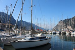 Sailboats dock at Lake Riva, Italy. Under the mountains Royalty Free Stock Photography