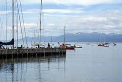 Sailboats at a dock in Ushuaia Harbor. Sailboats at a wooden pier, and moored in Ushuaia Harbor, Argentina Royalty Free Stock Image