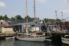 The sailboats are docked, the masts are stowed away. royalty free stock photos