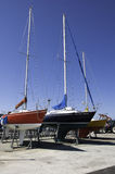 Sailboats in a dry dock. Beeing repaired Stock Photos